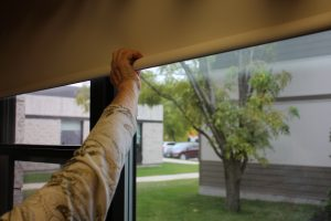 Resident using the new cordless roller blinds